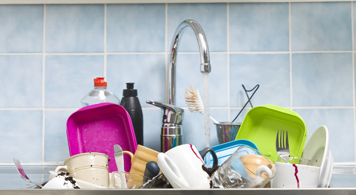 Kitchen Sink Filled with Items