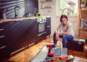 Stressed Woman Before Kitchen Remodeling